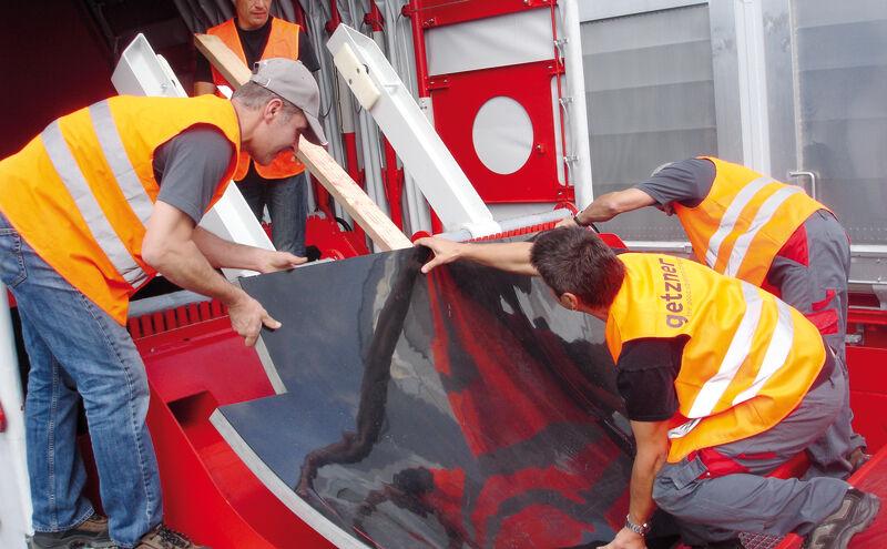 Elastische Muldenauskleidung auf Güterwaggon